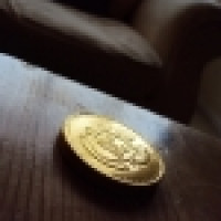 1253358_gold_coin_on_wooden_table